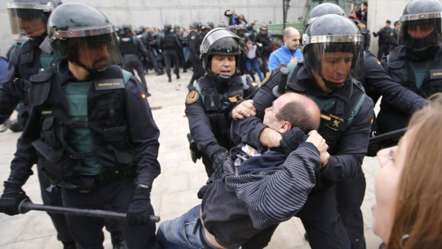 Spain's national police take to the streets to disrupt the Catalonian independence vote.