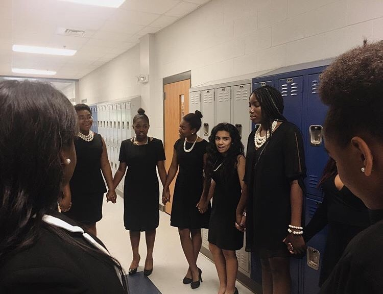 A group of WISE members before the Black History Program performance.