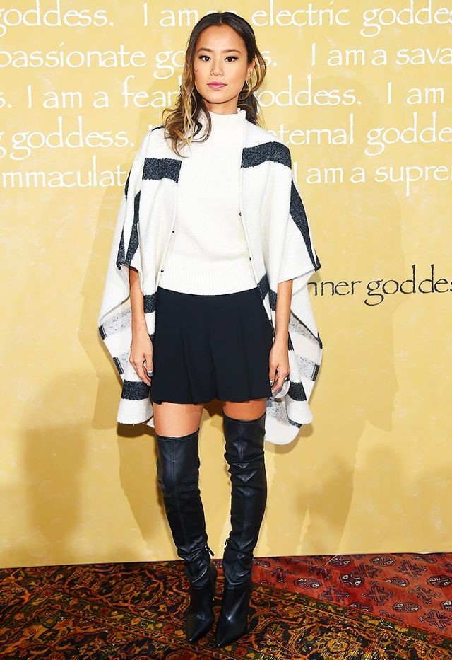 Jamie Chung works to make the unwieldy over-the-knee boots look appealing.