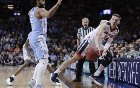 Virginia takes ACC tournament, loses first round in NCAA