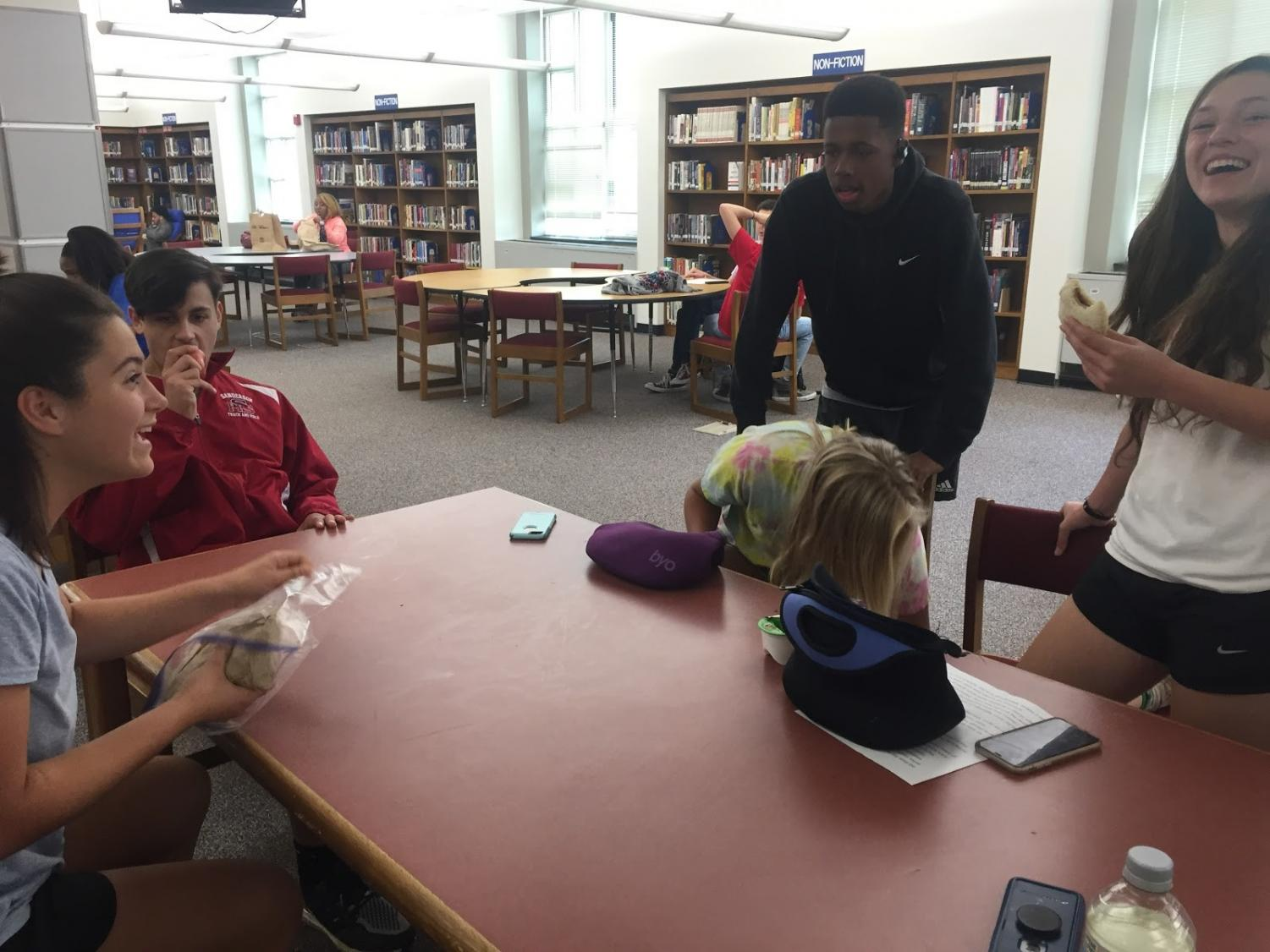 Sanderson students enjoy their lunch in the library.