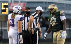 College football returns with precautions like masks for referees.