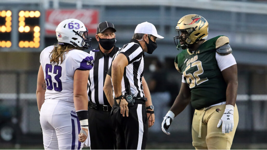 College+football+returns+with+precautions+like+masks+for+referees.