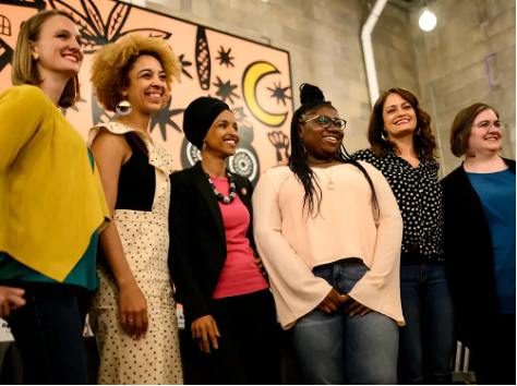 Panelists at a meeting about gender pay gap and equity in 2019