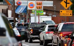 People Lining up at a gas station to fill up their tanks due to the cyber attack on the main east coast pipeline.