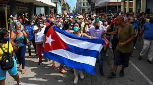 This wasn't the first Cuban revolution-- as thousands gathered in the streets last summer, the Latin-American community experienced gut-wrenching deja vu.